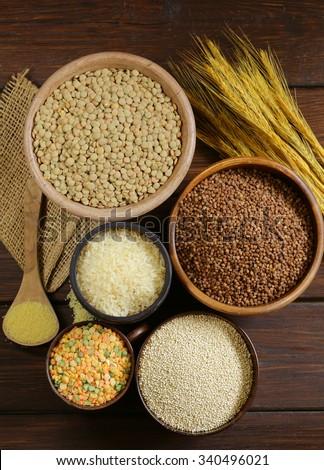 assortment of different grains - buckwheat, rice, lentils, quinoa - stock photo