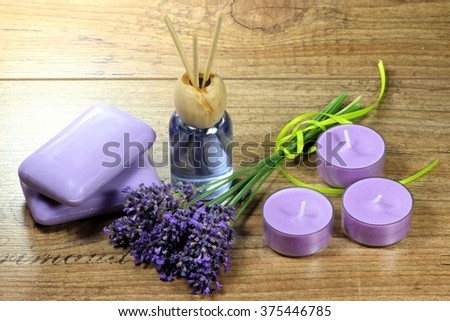 assortment of different lavender products on wooden background - stock photo