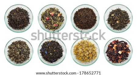 Assortment of dried tea leaves. Different kinds of green tea, black tea and herb tea on glass saucer isolated on white background. - stock photo