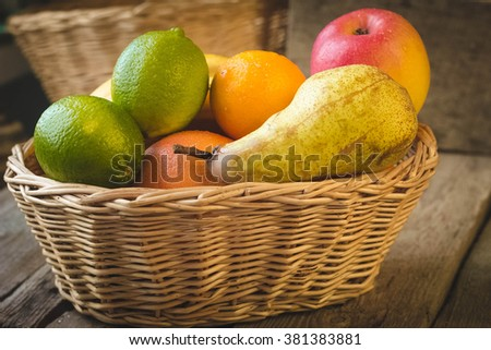 Assortment of exotic fruits in basket - stock photo