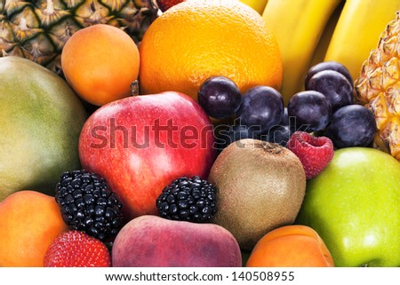 Assortment of exotic fruits in studio - stock photo