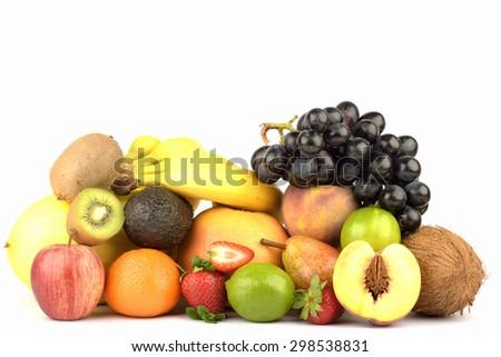 Assortment of exotic fruits isolated on white - stock photo