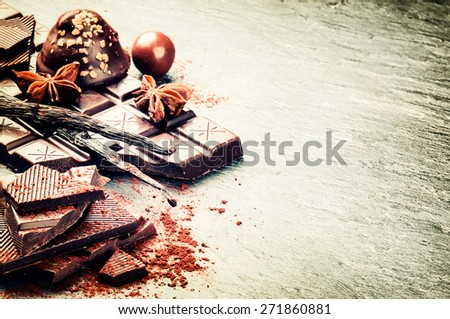 Assortment of fine chocolates and pralines on dark background - stock photo