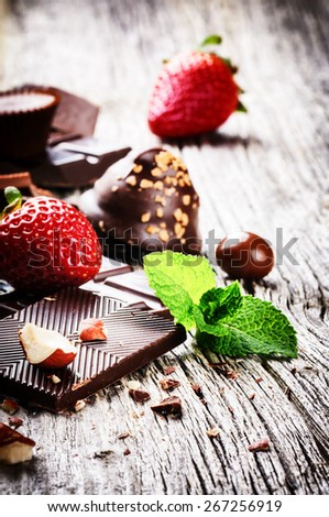 Assortment of fine chocolates and pralines with fresh strawberry - stock photo