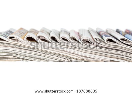 Assortment of folded newspapers isolated on white. Breaking news, journalism, power of the media, newspaper and magazine ads and subscription concept. Great for a web site header or banner.  - stock photo