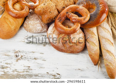 Assortment of  fresh baked bread on a wooden table. Top view