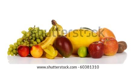 Assortment of fresh fruits isolated on white background - stock photo