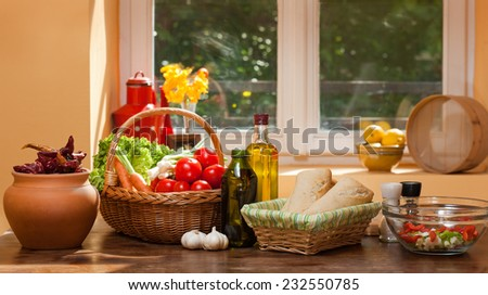 Assortment of fresh healthy groceries on display in the kitchen. - stock photo