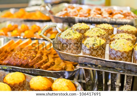 Assortment of fresh pastry on table in buffet.