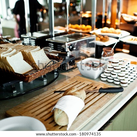 Assortment of fresh pastry on table in buffet with toaster - stock photo