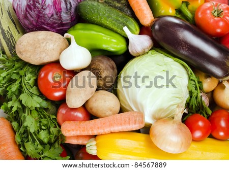 Assortment of fresh vegetables as a background - stock photo