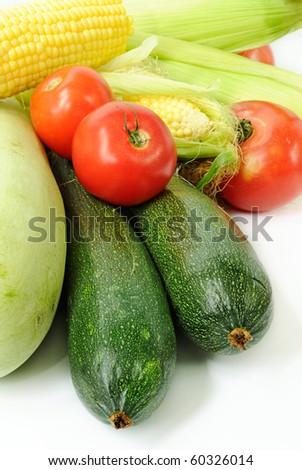 assortment of fresh vegetables closeup on white background - stock photo