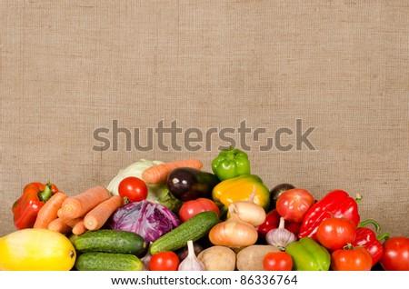 Assortment of fresh vegetables on on sacking background - stock photo