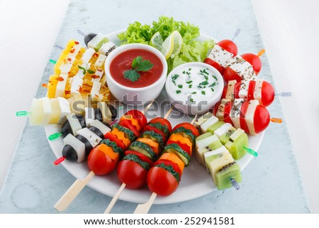 Assortment of fruit and vegetable appetizer with dips - stock photo