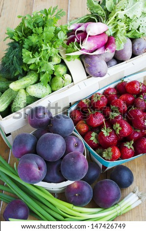 Assortment of fruits and vegetables in the baskets. Black Apricots - hybrid apricot and cherry-plum
