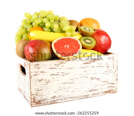 Assortment of fruits in box isolated on white - stock photo
