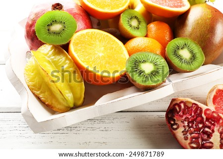 Assortment of fruits on wooden table - stock photo