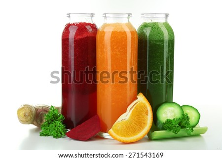 Assortment of healthy fresh juices in glass bottles, isolated on white