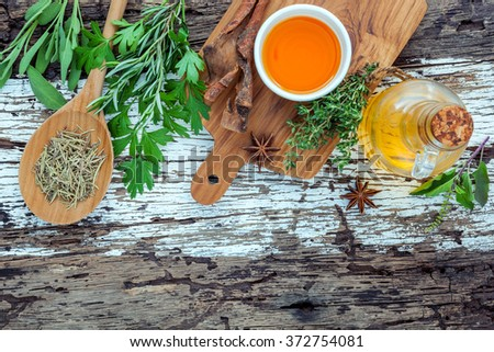 Assortment of herbs rosemary ,thyme,sage and parsley set up with wooden background concept for international cuisine. - stock photo
