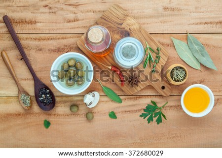 Assortment of herbs rosemary ,thyme,sage, mint,bay leaves , pepper and parsley set up with wooden background concept for international cuisine. - stock photo