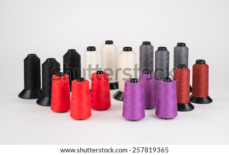Assortment of Industrial Thread on large spools. - stock photo