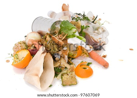 Assortment of kitchen waste waiting to be composted isolated over white background. - stock photo