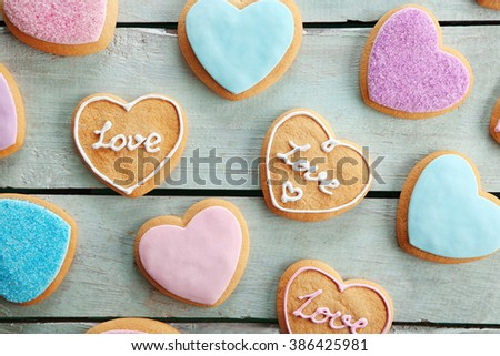 Assortment of love cookies on blue wooden table background - stock photo
