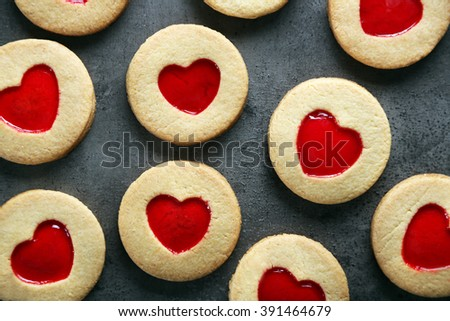 Assortment of love cookies on grey background - stock photo
