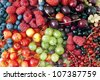 assortment of many fresh berries and fruit abstract  background - stock photo