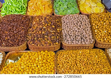 Assortment of nuts and dried fruits at a market - stock photo