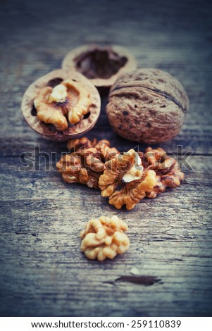 Assortment of nuts on wooden table - stock photo