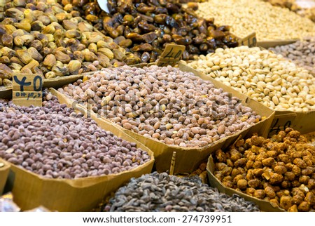Assortment of nuts: peanuts and pistachio at moroccan market in Marrakesh
