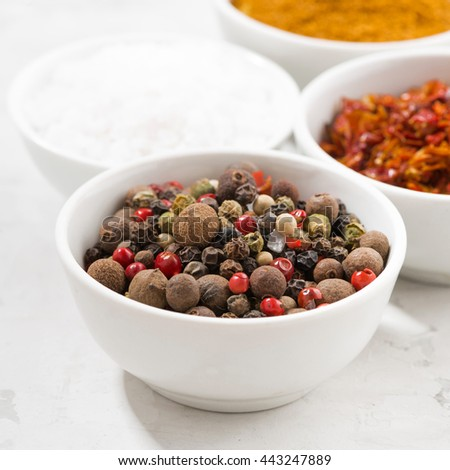assortment of pepper, salt and spices in bowls, closeup