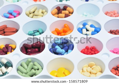 assortment of pills and capsules of colors - stock photo