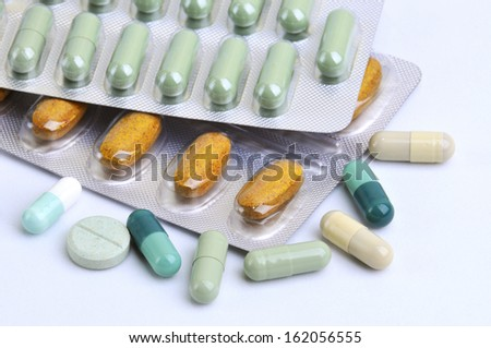 assortment of pills and capsules of natural medicine, herbal and homeopathic isolated in white