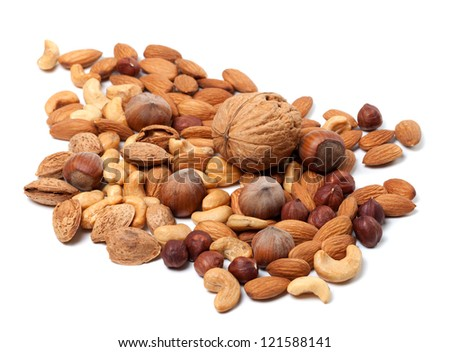 Assortment of raw and roasted nuts on white background