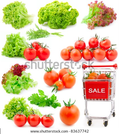 Assortment of red cherry tomatoes and lettuce leaves, isolated on white background