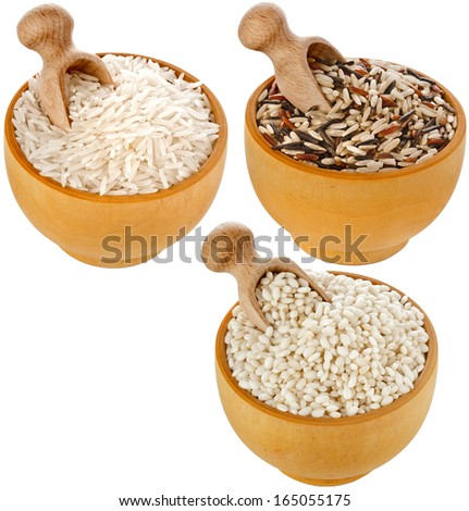 Assortment of rice in wooden dish and scoop  isolated on white background - stock photo
