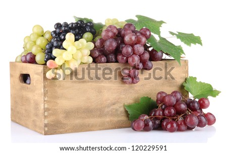 assortment of ripe sweet grapes in wooden crate, isolated on white - stock photo