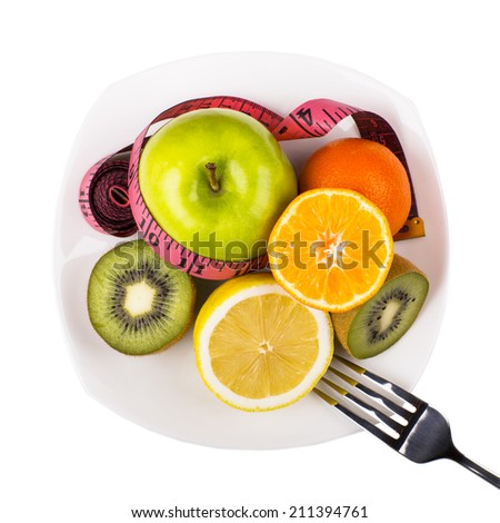Assortment of sliced fruits on plate - stock photo