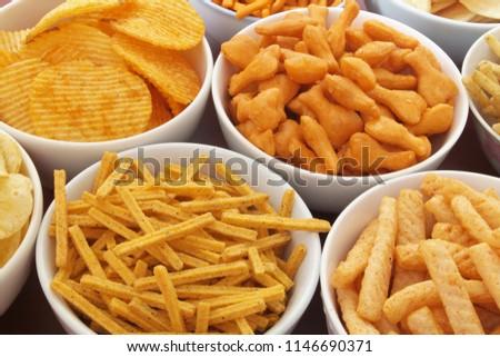 stock-photo-assortment-of-snackes-on-bro