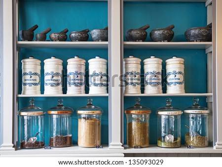 assortment of spice jars on shelves with price tags - stock photo