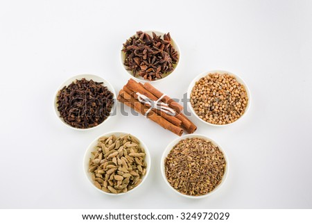 Assortment of spice,Star anise,coriander seed,cardamom,clove,cinnamon and cumin seed in white bowls over white background - stock photo