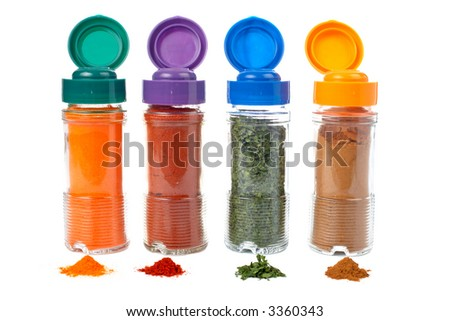 Assortment of spices jars for prepare tasty food with shadow over a white background. Shallow DOF - stock photo