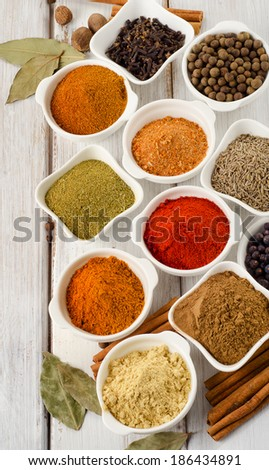 Assortment of spices on wooden table. Selective focus