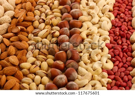 assortment of tasty nuts, close up - stock photo