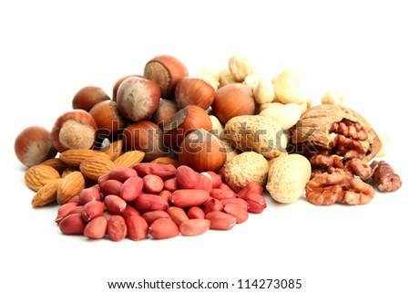 assortment of tasty nuts, isolated on white - stock photo