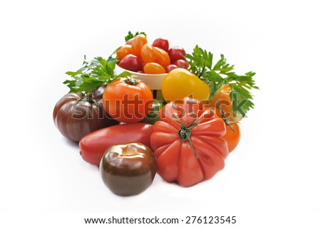 assortment of tomatoes with different  forms and colors on white background - stock photo