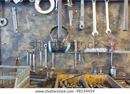 assortment of tools hanging on the wall - stock photo