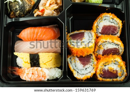 Assortment of traditional japanese sushi - stock photo